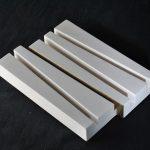 57 - polimero acrilico/inerti minerali/doratura