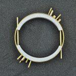 94BI/E1 - micro inerti/ottone placcato oro